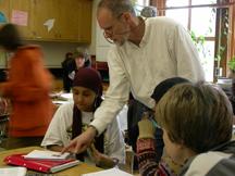 Teacvher helping students